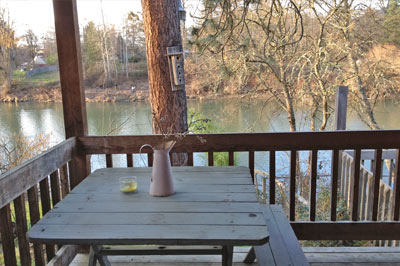 outdoor patio with riverfront view